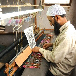 Le tissage kani : le dessin du modèle est codé