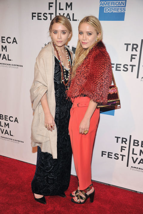 ashley olsen on the red carpet with a beige pashmina